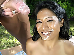 Seductive Asian Lyla Lei goes for a wild outdoor sex picnic and oozes with facial cumshot